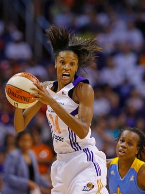 Phoenix Mercury guard/forward DeWanna Bonner hauls in a pass against the Chicago Sky during the first half of Game 1 of the WNBA Finals on Sept. 7  2014.