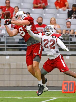 Arizona Cardinals tight end Troy Niklas has a pass broken up by strong safety Tony Jefferson (22)  during  training camp on Tuesday, Aug. 11, 2015, in Glendale.