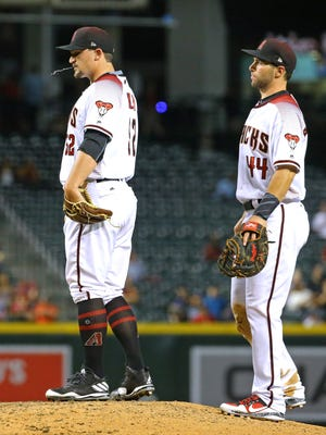 Arizona Diamondbacks pitcher Zack Godley reacts with first baseman Paul Goldschmidt (44) after giving up a RBI double to San Diego Padres starting pitcher Trevor Cahill (38) in the fourth inning of their MLB game Wednesday, April 26, 2017 in Phoenix, Ariz.