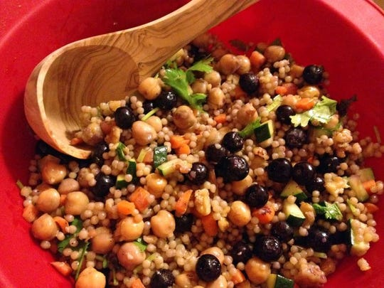 Vegetable couscous with blueberries makes an easy and filling main course or side dish with the chickpea protein, Israeli pearl couscous, nuts, vegetables and fruit.