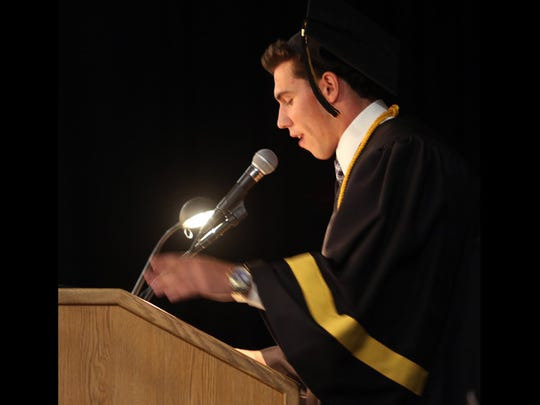 Graduating senior Jake Ashton delivers the farewell to the class of 2014 as Xavier College Prep celebrated it's fifth graduating class in a cermony at the Palm Desert school Saturday, May 31, 2014.