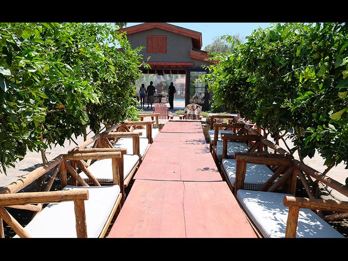 Long dining tables in a row of citrus trees at The Sparrows Lodge in Palm Springs CA,Tuesday, August 19, 2014.