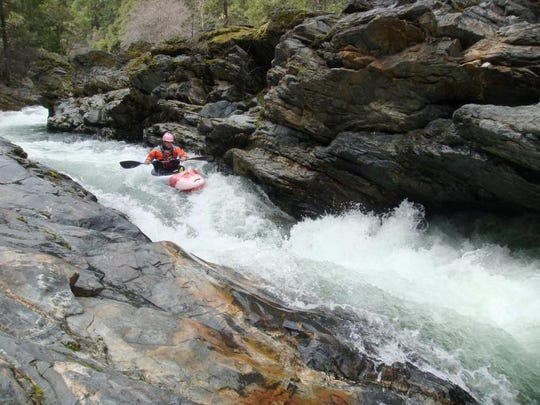 Brock Nelson runs a Class V rapid past a dangerous undercut on the upper Applegate River, high above the reservoir.