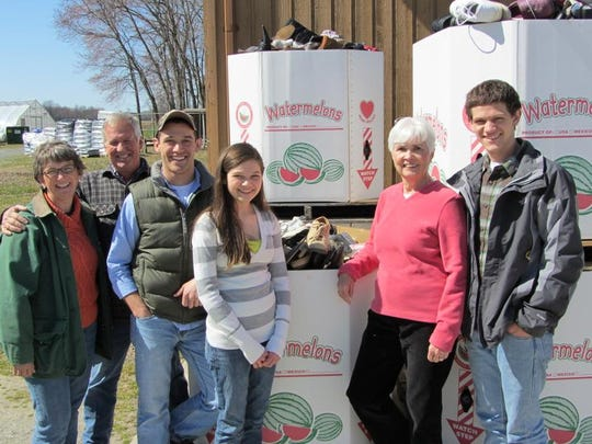 The family – mom Lori Ockels (from left), stepdad Dennis Ockels, brother Justin Rider, Emma Rider, Jean Hinckley, who is like a grandmother to Emma and who has hauled many loads of shoes, and brother Nathan Rider – collects the shoes in donated watermelon boxes.