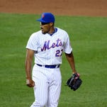 Mets relief pitcher Jeurys Familia (27) reacts to the win against the Atlanta Braves at Citi Field. New York Mets won 3-2.