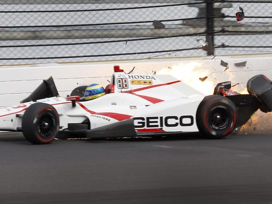 Dale Coyne Racing IndyCar driver Sebastien Bourdais (18) hits the wall coming out of turn two during qualifying for the Indianapolis 500 Friday, May 20, 2017, afternoon at the Indianapolis Motor Speedway.