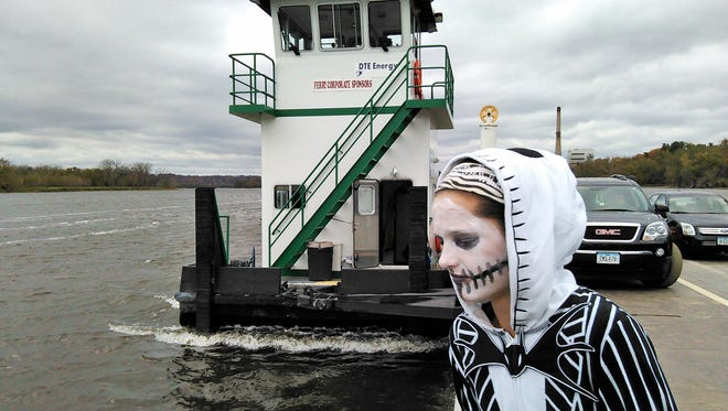 Spookily dressed for a Halloween excursion with friends and family, Karoline Stratton, 14, of Dubuque ponders the Mississippi River on Saturday afternoon aboard the Cassville Ferry.