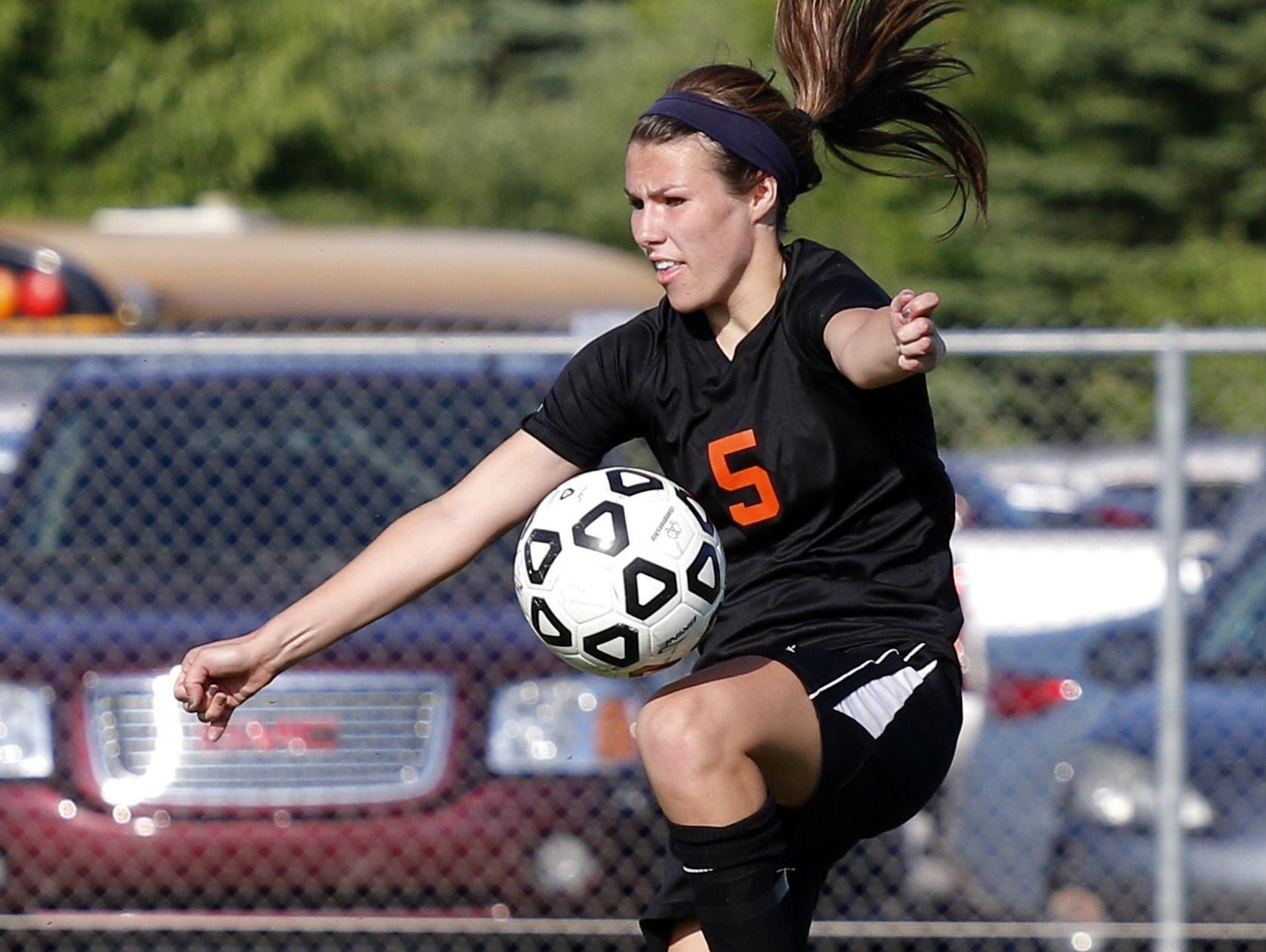 Leslie's Abigale Bowers controls the ball against Jackson Lumen Christi in their soccer regional game, Wednesday, June 3, 2015, in Williamston, Mich.