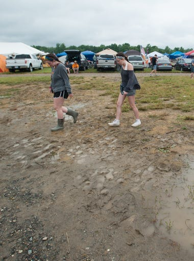 Campers avoid standing water in the camping area at Firefly Music Festival in Dover.