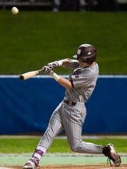 Mississippi State's Jake Mangum (15) puts a ball into