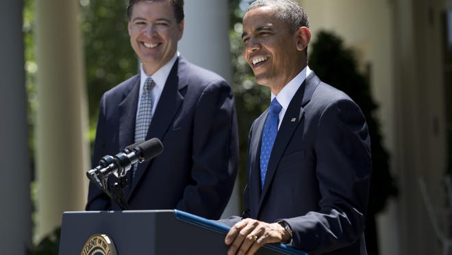 President Barack Obama smiles as he announces the nomination of James Comey, a senior Justice Department official under President George W. Bush, to replace Robert Mueller as FBI director, on June 21, 2013, in the Rose Garden of the White House.
