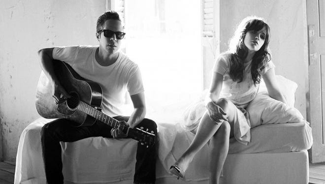 Promotional photo of the band She and Him