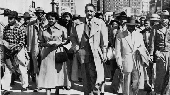 Autherine Lucy and NAACP attorneys Thurgood Marshall and Arthur Shore outside Federal Court in Birmingham during her struggle to integrate the University of Alabama. February, 1956.  (Associated Press)