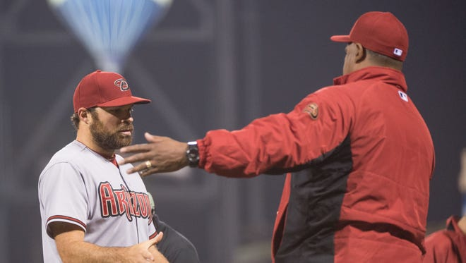 April 17, 2015: Arizona Diamondbacks starting pitcher Josh Collmenter (left) is congratulated after the game against the San Francisco Giants at AT&T Park.