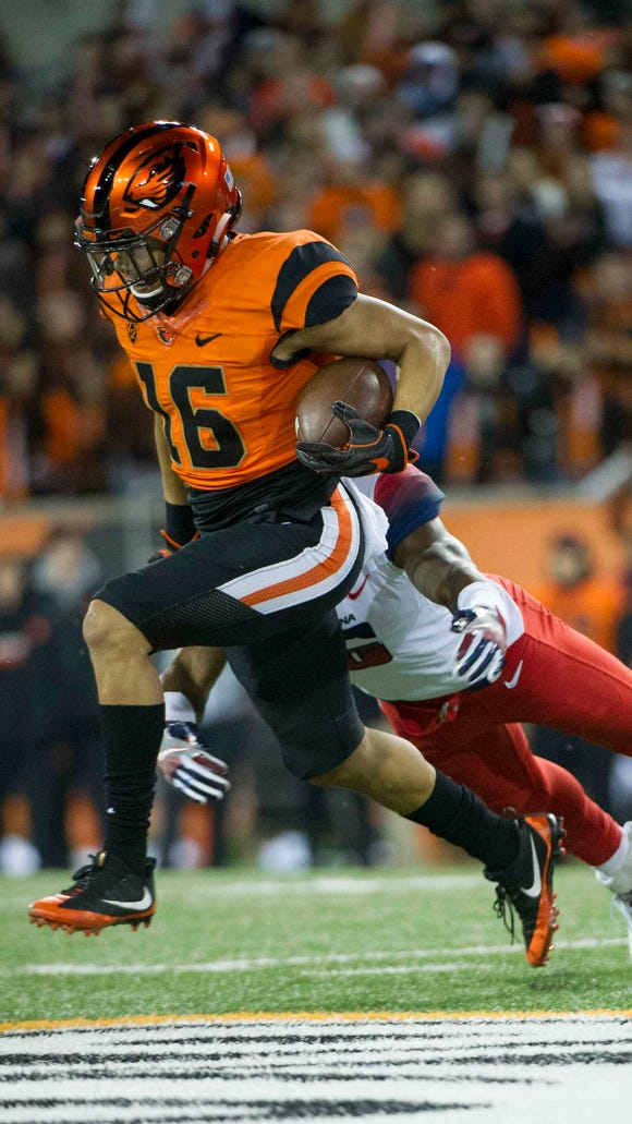 Nov 19, 2016; Corvallis, OR, USA; Oregon State Beavers wide receiver Paul Lucas (16) is tackled by Arizona Wildcats safety Demetrius Flannigan-Fowles (6) at Reser Stadium. Mandatory Credit: Cole Elsasser-USA TODAY Sports