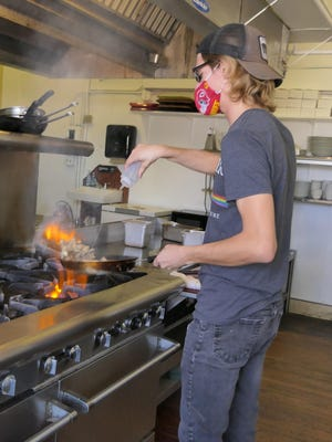 Ethan Jensen cooks homegrown oyster mushrooms at Professor's Classic Sandwich Shop in Hays.