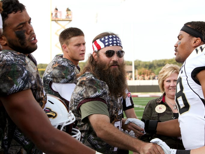 """Duck Dynasty"" star Willie Robertson prepares for the pregame coin toss between the University of Louisiana at Monroe and Wake Forest on Thursday. Robertson joined fans and players in sporting camouflage at the ""Camo-Out"" game."