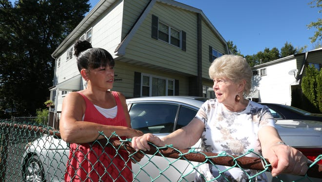 Lonergan Dr. Suffern homeowners Yvonne Staples, left, and Anne Ingrisone at Ingrisone's home, Aug. 29, 2016. They would like to get the state to purchase their houses in the flood prone neighborhood.