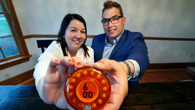 Physician's assistant Afton Heitzenrater of Spencerport, N.Y., and her husband, Jeff Heitzenrater, developed a smart pill bottle to release medication, an invention they hope will help keep patients from becoming dependent on opioids.