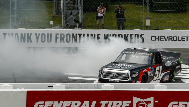 Brandon Jones smokes the tires in celebration after winning the NASCAR Truck Series race at Pocono Raceway, Sunday, June 28, 2020, in Long Pond.