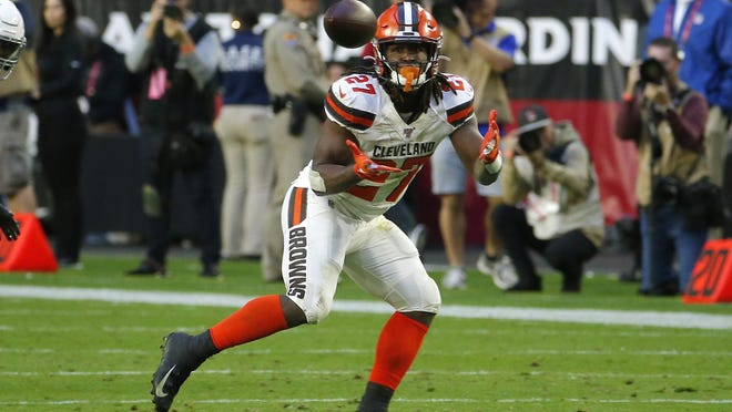 Browns running back Kareem Hunt prepares to make a catch during a game in December.