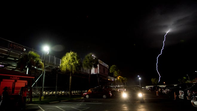 Lightning strikes after the Riverdale- Cape Coral high school football was cancelled on Friday, August 22, 2014, at Riverdale High School.