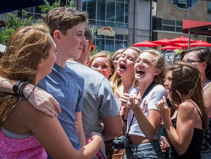 "Fans scream after getting the chance to see 15-year-old pop star Trevor Moran in person. After first appearing in the live auditions of ""The X Factor,"" Moran began releasing singles."