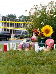 A memorial grows near the Hancock Arms Apartments complex in Keansburg Friday,  July 14, 2017, near where the remains of 11-year-old Abbiegail 'Abby' Smith were found Thursday.