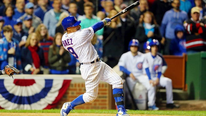 Javier Baez hits a game-winning home run in the eighth inning.