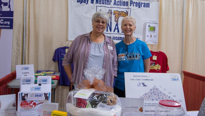 Suzanne Bramlett, left and Elaine Stacherasimon at the Spay and Neuter Action Program booth during the DogCruces Pet Expo held at the Las Cruces Convention Center on September 9, 2018.