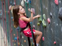 Young Girl at Indoor Climbing Gym