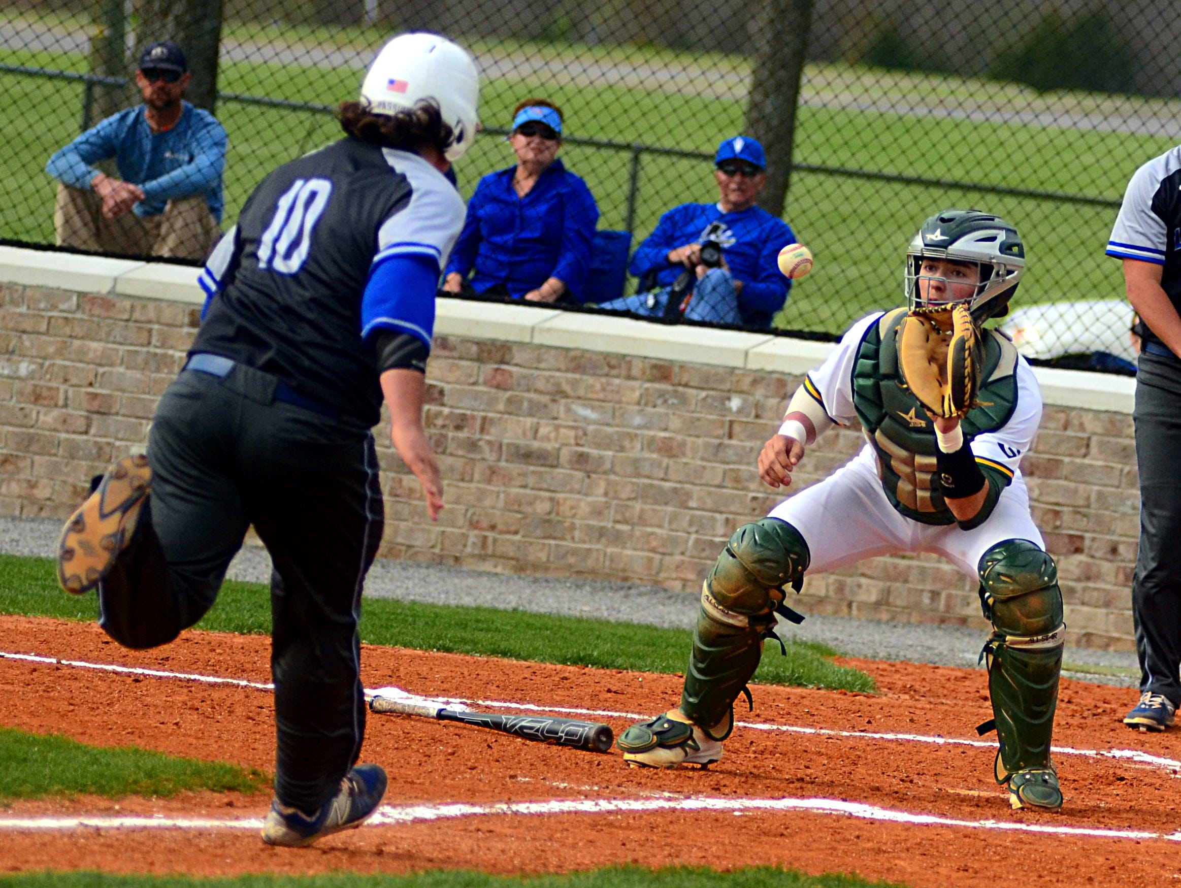 Gallatin High junior catcher Bailey Russell receives a throw at home plate as Lebanon junior Dalton Squires attempts to score during second-inning action.