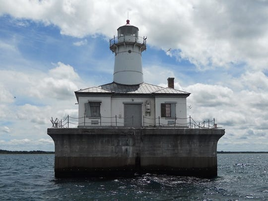 The Fourteen Foot Shoal Lighthouse being auctioned is located at the northern end of Lake Huron and helps ships navigate to Lake Michigan.
