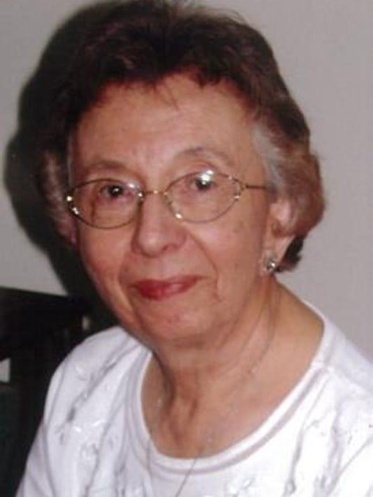 Gail Nothnalge photo in white blouse - sitting.png