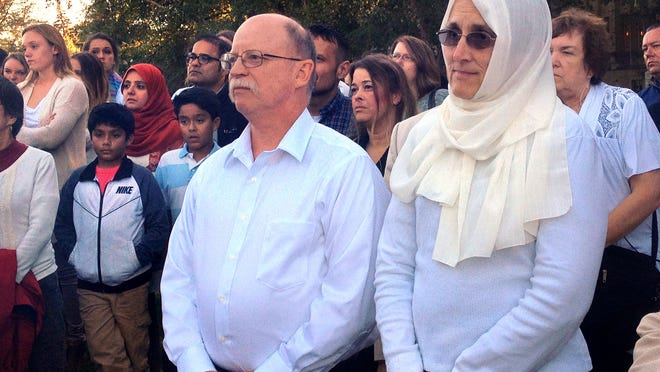 Ed and Paula Kassig, Indianapolis, parents of ISIS hostage Peter Kassig (Abdul-Rahman Kassig), attend the prayer vigil for their son on the Atherton Student Union Mall at Butler University on Wednesday, October 8, 2014. The Kassigs did not speak at the event, organized by the Muslim Student Association, but listened to speeches and prayers offered by various local Muslim leaders.