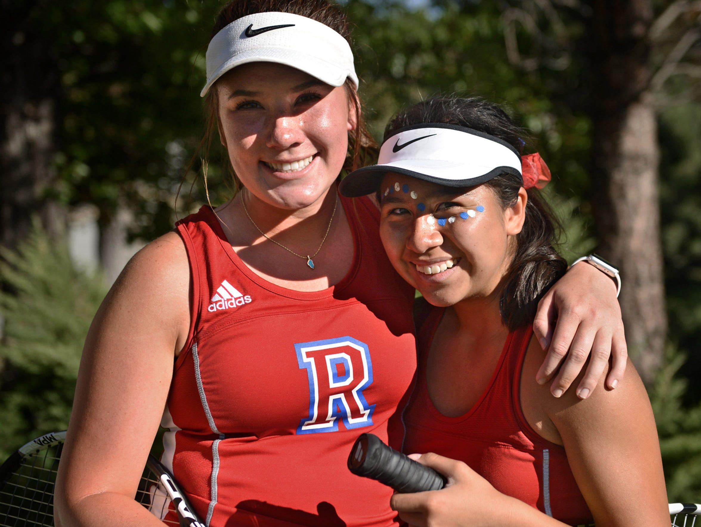 Reno High's tennis doubles partners Jill Rovetti, left,