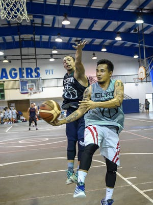 The Guam Men's National Basketball Team practices at the Jose Rios Middle School gym in Piti on May 27. 