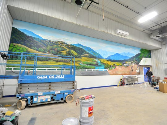 Pictured above is a recently finished mural at the