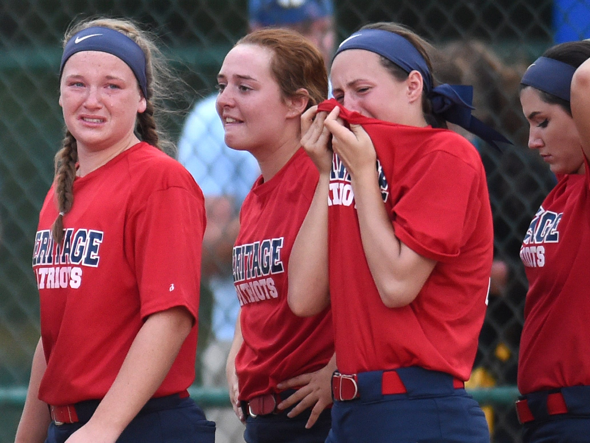 White House Heritage players react after losing 4-0 in a Class AA state championship softball game to CAK at StarPlex Park in Murfreesboro during Spring Fling on Friday, May 27, 2016.
