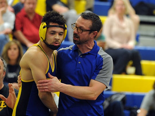 Wi-Hi's Keith Blades talks with his coach at the Bayside