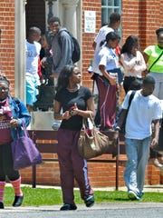 Students leave after the last day of school at St. Jude on Friday, May 23, 2014.