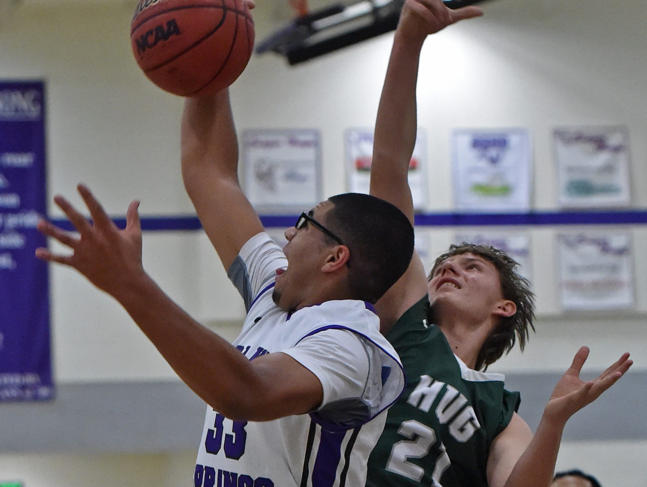 Spanish Springs' Marcus Loadholt beats Hug's Drake Newman to a rebound during the first half of Tuesday's game at Spanish Springs.