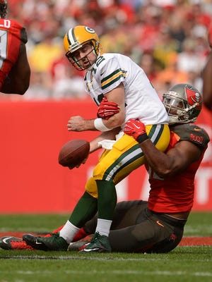 Green Bay Packers quarterback Aaron Rodgers is sacked by Tampa Bay Buccaneers defensive end Michael Johnson during the first quarter of Sunday's game at Raymond James Stadium in Tampa, Fla.