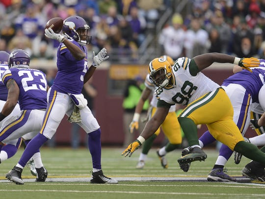 Green Bay Packers defensive tackle Letroy Guion (98) pressures Minnesota Vikings quarterback Teddy Bridgewater (5) in the third quarter during Sunday's game at TCF Bank Stadium on the campus of the University of Minnesota in Minneapolis. Evan Siegle/Press-Gazette Media