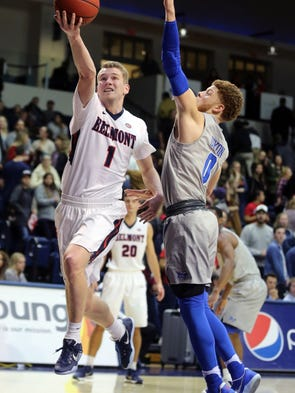 Belmont's Austin Luke attempts a basket while being