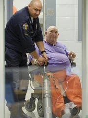 Murder suspect Edward Wayne Edwards is arraigned in August 2009 on a fugitive warrant at Metro Corrections in downtown Louisville. Edwards is accused of killing two Wisconsin teenagers nearly 30 years ago.