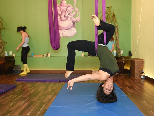 Instructor Alexandra NIkolova demonstrates a pose during an Intro to Aerial Silks class at Live Beyond Limit on Friday, January 20, 2017.