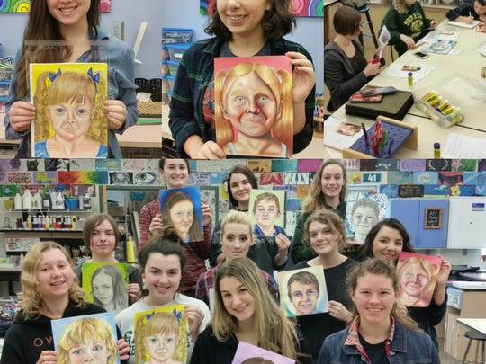 Seneca High school art majors show portraits they drew from photographs orphans in Ukraine they have never met. The art was done for the Memory Project, a nonprofit that connects youth internationally through art.