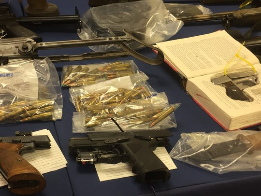 Guns and ammunition seized by state police.