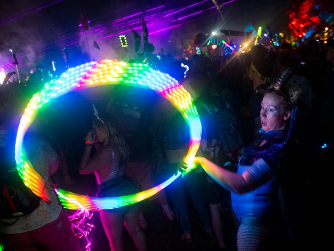 Mallory Beard hula hoops as Bassnectar performs at